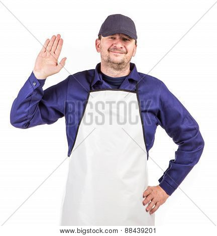 Worker wearing white apron.