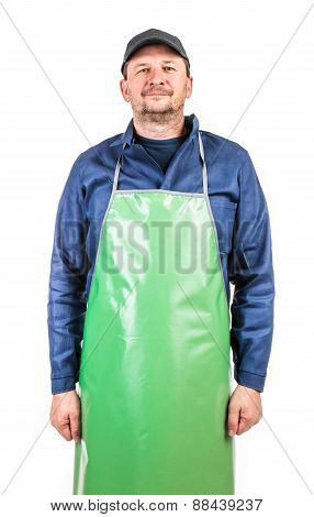Worker wearing blue apron.
