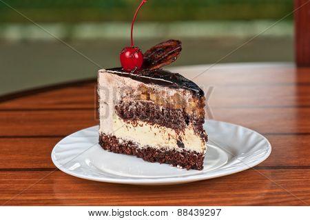 tasty piece of cherry cake closeup