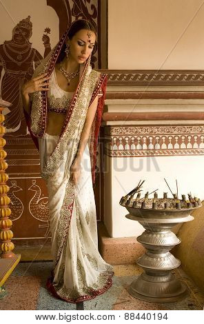 Beautiful Young Indian Woman In Traditional Clothing With Bridal Makeup And Oriental Jewelry. Easter