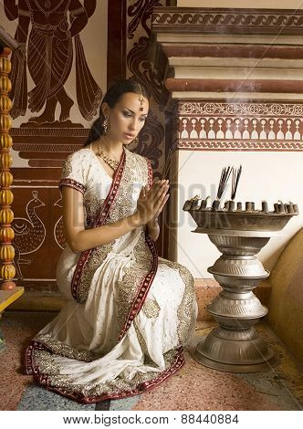 Beautiful Young Indian Woman In Traditional Clothing With Incense, Bridal Makeup And Oriental Jewelr