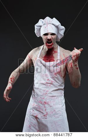 butcher man. aggressive maniac chef in the blood