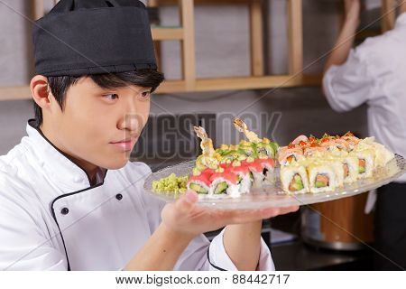 Cook shows a sushi set