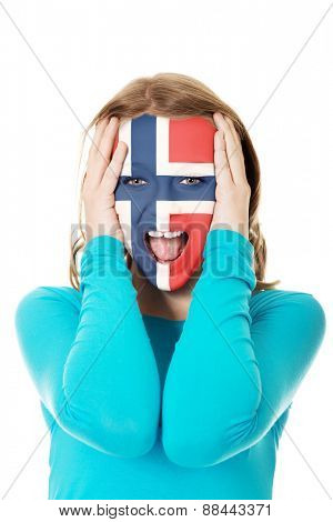 Woman with Norway flag painted on face.
