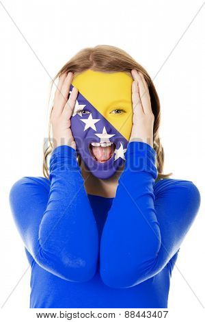 Woman with Bosnia and Herzegovina flag painted on face.