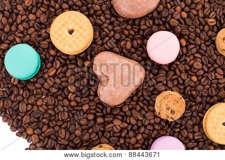 Cookies on coffee beans with macaroons.