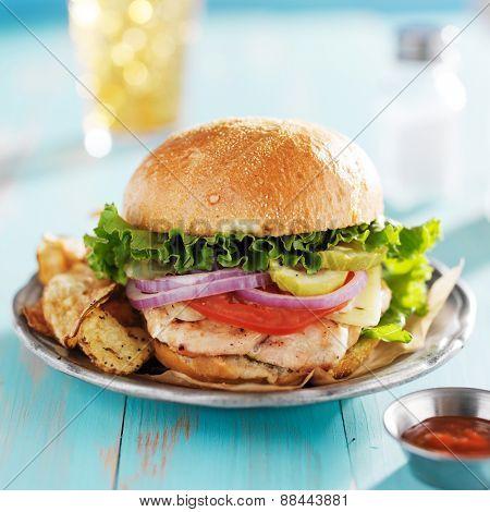 big grilled chicken sandwich on brioche bun