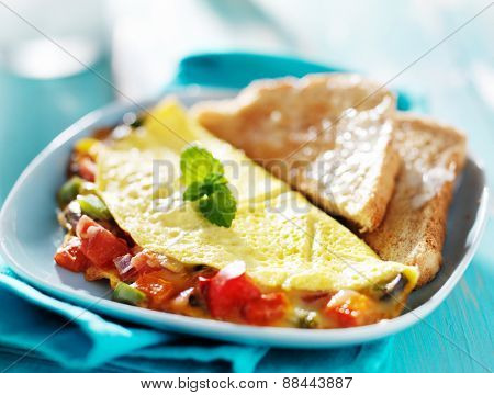 breakfast  omelet with buttered toast