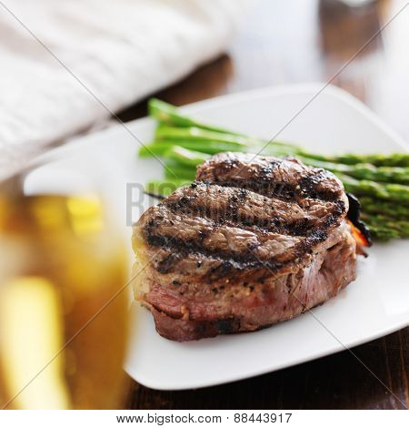 beef steak filet with asparagus and white wine