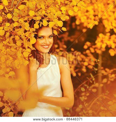 Beautiful woman in autumn park. Portrait