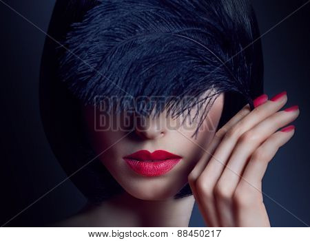 Beautiful portrait brunette girl with silky hair and black feather