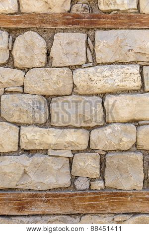 Wall Of The House Lined With Stones