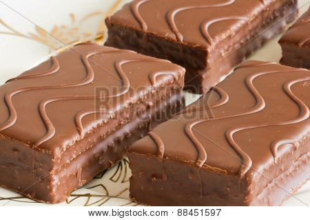 Sponge cake with chocolate on the plate