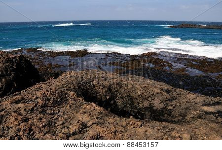 Waves And Volcanic Rocks