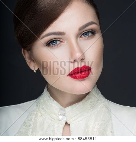 Beautiful girl with red lips in white clothes in the form of retro. Beauty face.