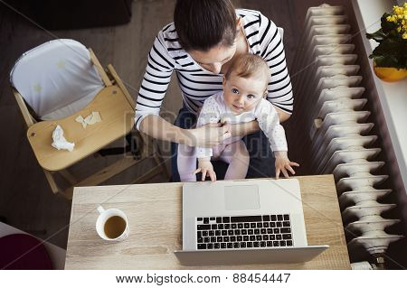 Young mother working from home