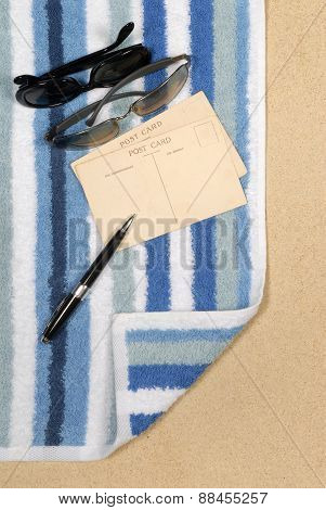 Seashore Background With Sunglasses And Towel