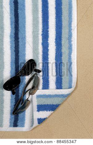 Seashore Scene With Towel And Sunglasses