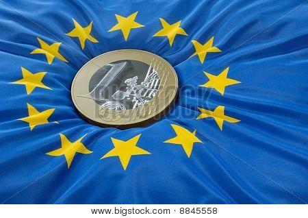 Euro coin on a european flag