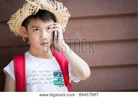 Asian Boy Speaks By Phone