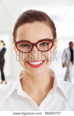 Beautiful toothy smiling businesswoman in eye glasses.