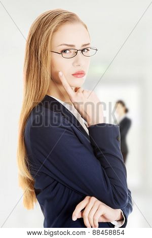 Beautiful thoughtful confident businesswoman in a suit.