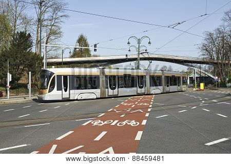 A Tram Passes Through The Intersection