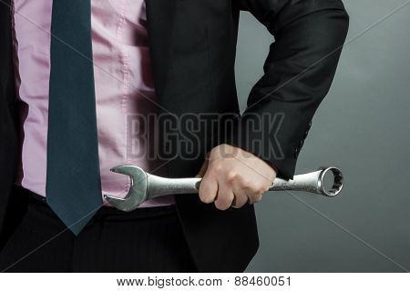Businessman Holding Spanner In Hand