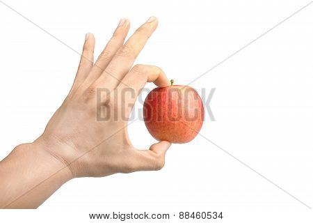 Red Apple In A Male Hand Isolated On White Background