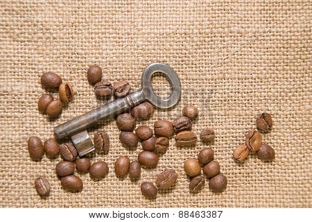 Vintage Key And Coffee Beans On  Cloth