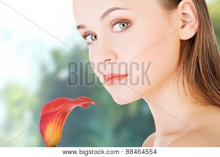 Beauty woman with a red lily flower