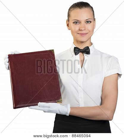 Young waitress in white gloves holding folder