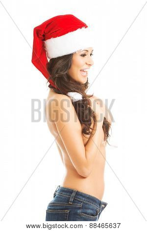 Side view of beautiful woman shirtless wearing santa claus hat.