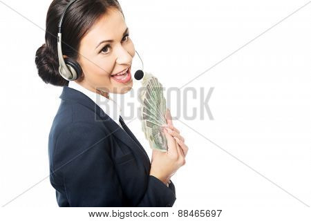 Portrait call center woman holding a clip of polish money.