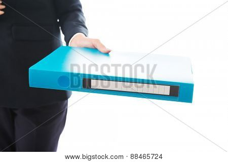 Close up on businesswoman giving a binder.