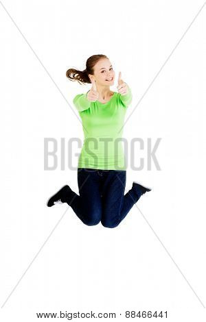 Happy laughing woman jumping for joy.