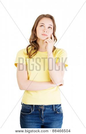 Photo of pensive young student woman.