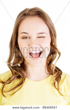 Portrait of happy woman blinks her eye.