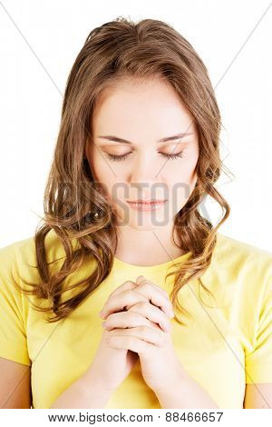 Portrait of a woman praying.