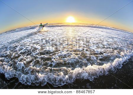 Gold Coast Australia beach sunrise over ocean, surfer