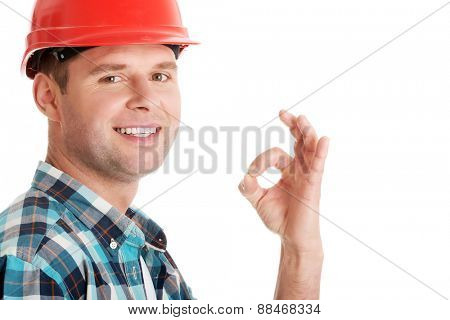 Confident engineer showing OK sign.