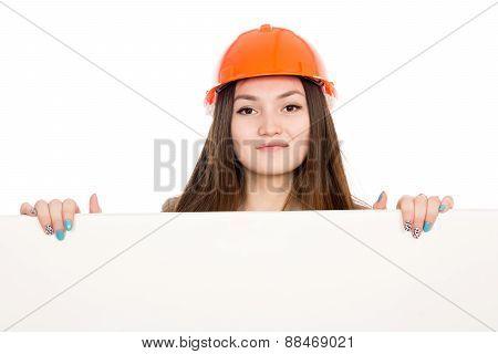 Girl Builder In Helmet Showing A Blank Banner.
