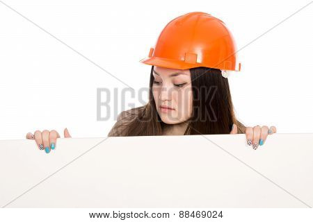 Girl Builder In Helmet Looking At A Blank Banner.