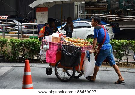 A Vendor Looks For Customer On A City Centre Street In Bangkok