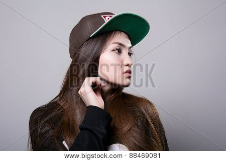 Young Girl In A Cap.