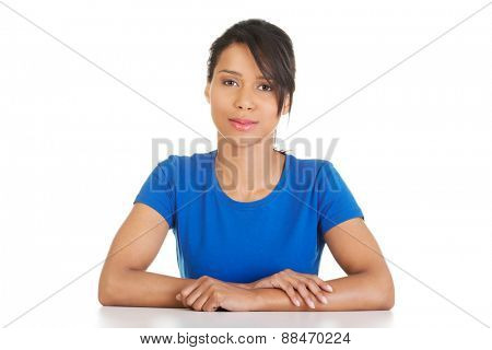 Portrait of a woman sitting at the desk.