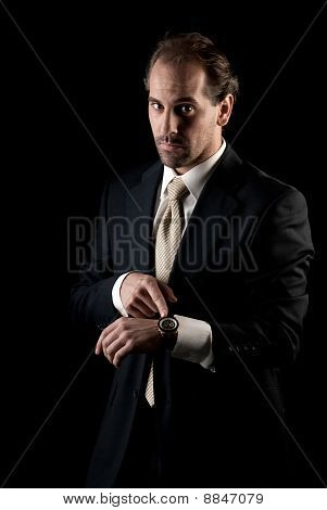 Adult Businessman Pointing To Clock, Arrive Late Deadline Concept
