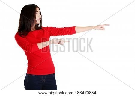 Woman pointing to the left.