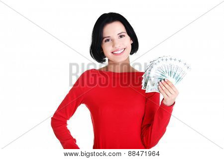 Happy woman holding polish bills.