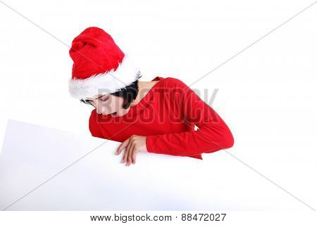 Woman in santa clothes with white empty banner.